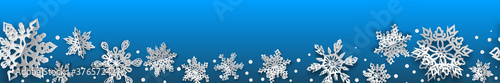 Fotografia Christmas seamless banner with volume paper snowflakes with soft shadows on light blue background