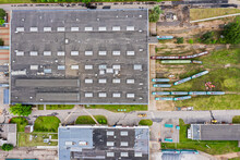Industrial Buildings In Tram Depot With The Trams Which Are Standing One By One. Birds Eye View