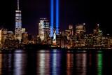 Fototapeta Nowy Jork - 9/11 Memorial Beams with Statue of Liberty and Lower Manhattan.