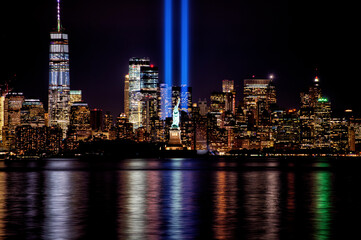 9/11 Memorial Beams with Statue of Liberty and Lower Manhattan.