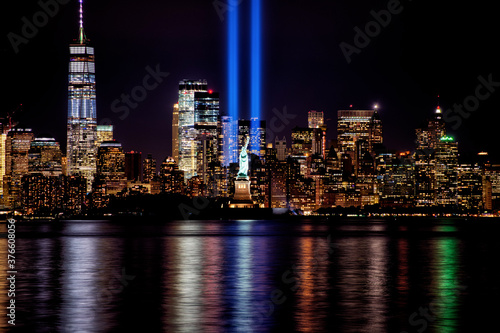 9/11 Memorial Beams with Statue of Liberty and Lower Manhattan. - 376608056