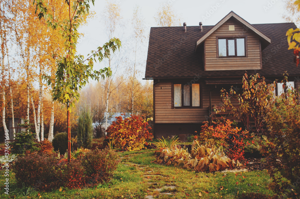 Fototapeta autumn wooden country house and garden view