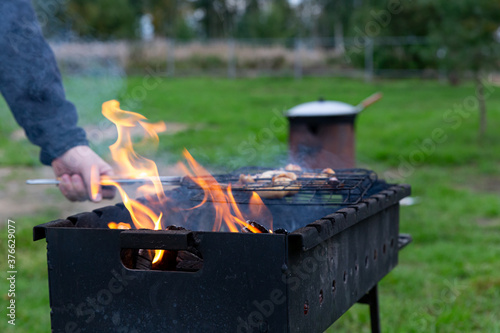 Photo The meat is cooked on the grill, brazier