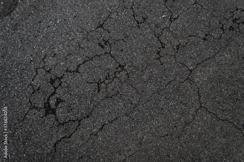 Foto Crack background texture of rough asphalt top view