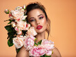 canvas print picture - Attractive brunette girl with big beautiful  bouquet of  flowers. Beautiful white girl with flowers.  Pretty woman with bright makeup. Art portrait with flowers.