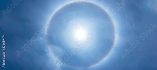 Fényképezés Beautiful sun halo phenomenon with circular rainbow, solar halo the ring