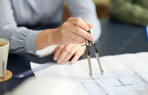 Fototapety, obrazy: construction business, architecture and building concept - close up of architect with blueprint and drafting compass working at office