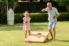Happy Family Playing Cornhole ...