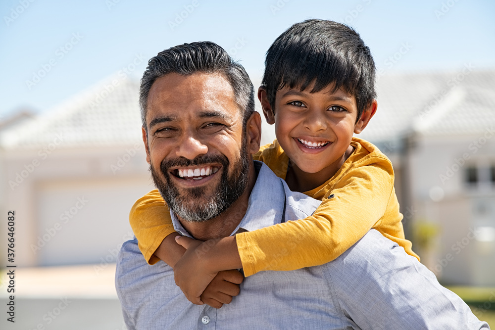 Fototapeta Father and son smiling together