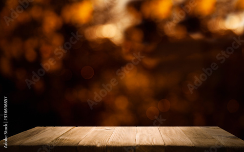 Obraz blurred background of bar and dark brown wooden desktop, place for a great product - fototapety do salonu