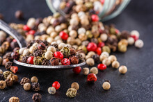 Mix Of Peppercorns On A Dark S...