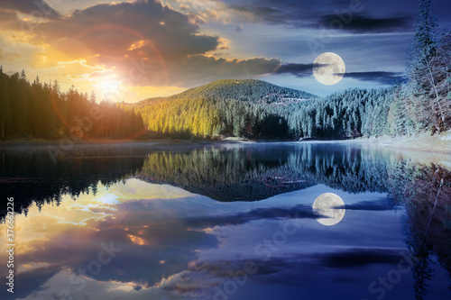 Fotografie, Obraz day and night time change concept above mountain lake among the forest