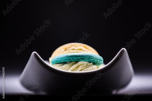 Fotografie, Obraz Macaroons of different flavors set on a dark background for a restaurant menu