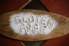 Gluten Free Flour On Wooden Cu...