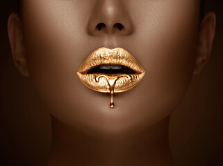 Golden lipstick closeup. Liquid metal dripping from gold lips. Beautiful makeup. Sexy lips, bright liquid paint on beauty African American model girl's mouth, close-up. Lipstick.