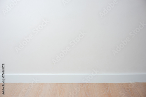 Obraz empty room with wooden floor - fototapety do salonu