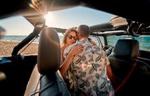 Couple On Beach With Car