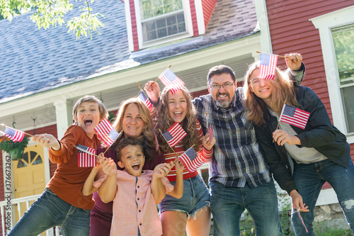 Photo All American Family Celebrating Waving USA Flags