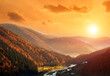 canvas print picture Dramatic sunset over valley in autumn mountains