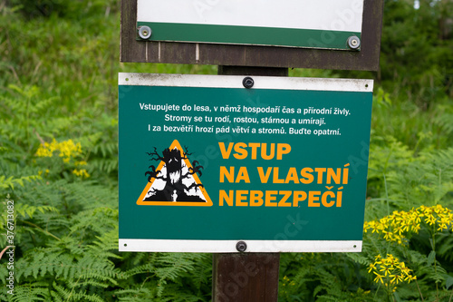 Enter at your own risk (text in czech language) - warning sign and signboard on entrance to the czech wood and forest Wallpaper Mural