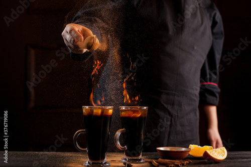 Fototapeta Preparation of mulled wine to serve, in a restaurant