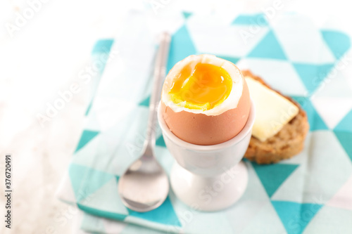 Fotografie, Obraz soft boiled egg with bread and butter