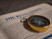 Compass On The Bible In The Book Of Revelation