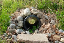 Looking Through A French Drain With A Black Pipe And Rocks Surrounded It