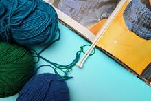 Group Of Various Yarn Balls And Knitting Needles Closeup
