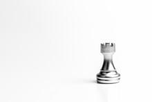 Silver Rook Chess Standing Alone On White Background. - Leadership Concept.