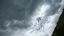 Balloons Rise In The Air Against The Background Of High-rise Buildings