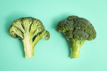 Two Fresh Green Broccoli On Mint Background
