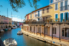 Colorful Houses And Boats On A Canal In Port Grimaud, On The French Riviera