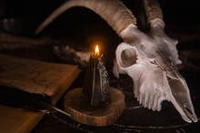 White Goat Scull With Horns, Open Old Book, Magic Spells, Runes, Black Candles