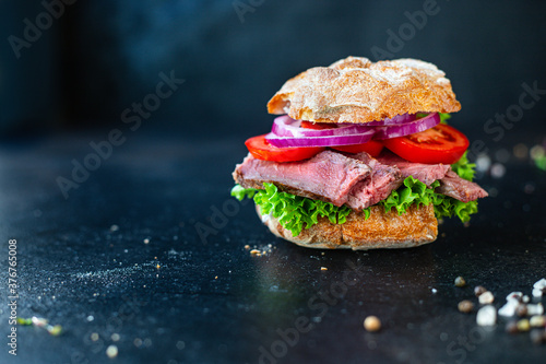 sandwich with meat and vegetables loaf of bread, tomato, lettuce, medium or rare Fototapet