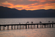 Silhouetted View Of Pier On South Lake Tahoe At Sunset, California, USA