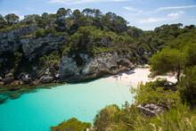 Distant View Of Holiday Makers On Beach, Cala Macarelleta, Menorca, Spain