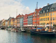 Sailing Boats, Sidewalk Restaurants And Colorful Townhouses, Nyhavn Harbor, Copenhagen, Denmark