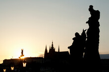Silhouetted Statues On Charles IV Bridge At Sunset, Prague, Czech Republic
