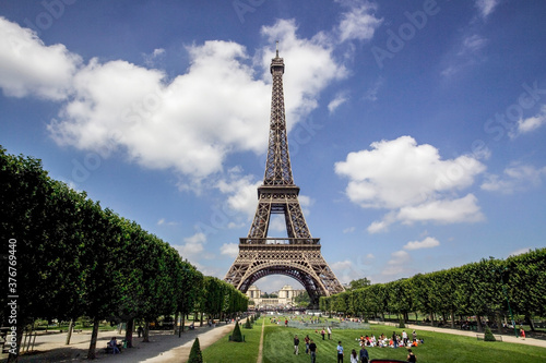 Tourists in Eiffel Tower park, Paris, France - 376769440