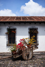 Flowering Pots In Old Cart On Cobbled Street, Antigua, Guatemala