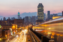 Subway Train, Queens. Midtown Skyscrapers With Empire State Building In Background, New York City, New York, USA