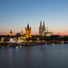 Waterfront Cityscape With Town Hall, Great St Martin Church And Cologne Cathedral (Koelner Dom) At Dusk, Cologne, Germany