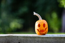 Halloween Pumpkins Or Jack-o-lantern At Home Terrace. Decoration And Holidays Concept