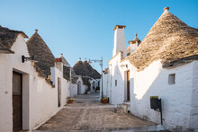 Paved Alley With Whitewashed Trullo Houses, Alberobello, Puglia, Italy