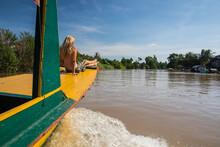 Female Tourist Sitting On Front Of River Boat, Battambang,  Cambodia