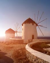 Two Traditional Windmills On Coast, Mykonos, Cyclades, Greece