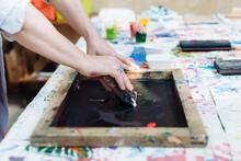 Man Doing Silk Screen Print In...