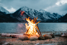 View Of Campfire Burning By Lake