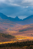 Scenic view of Tombstone mountain and autumn tundra